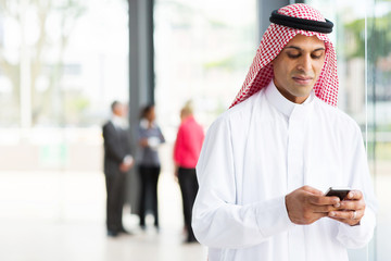 islamic businessman using smart phone