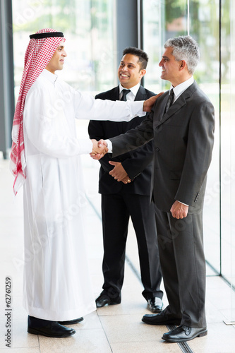 arabian businessman greeting business partners