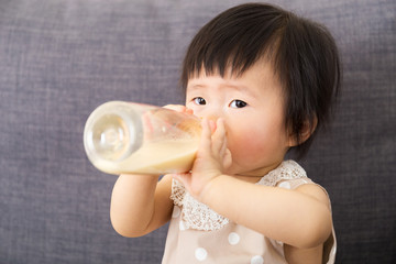 Asian baby girl feed with milk bottle