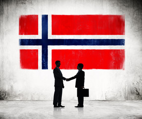 Silhouette of Business Handshake With Flag of Norway