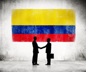 Businessmen Shaking Hands With Flag of Colombia