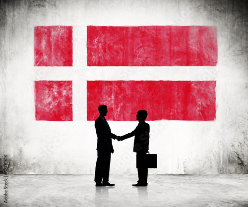 Businessmen Shaking Hands With Flag of Denmark