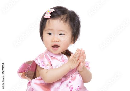 Chinese baby girl clapping hand