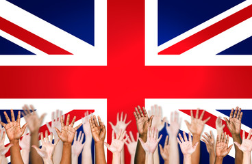 Multi-Ethnic Hands Raised With British Flag In Background