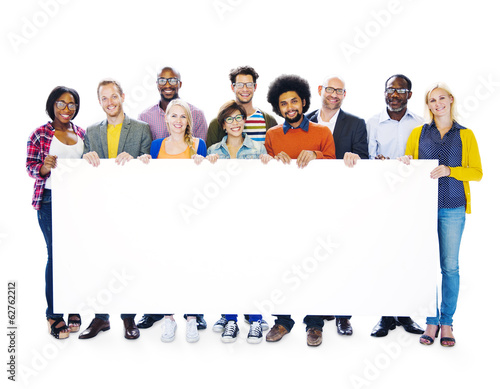 Group Of Multi-Ethnic People Holding Blank Billboard