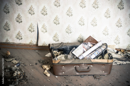 Old suitcase in abandoned room