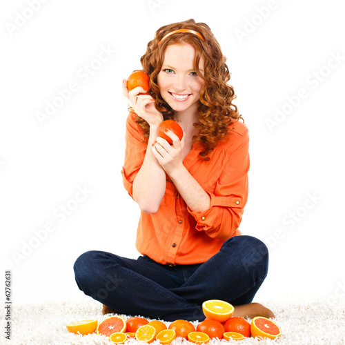 Portrait of a beautiful young woman with red hair oranges