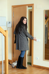 Woman in coat  leaving  home