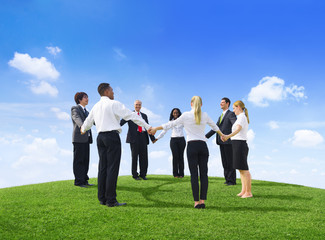 Business People Holding Hands On a Hill