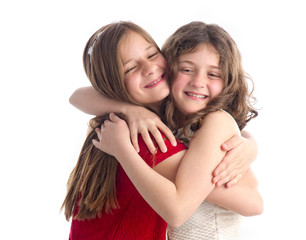 Two Beautiful Sisters hugging isolated on white