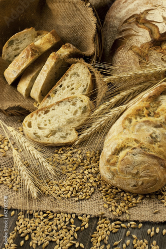 Freshly baked traditional bread on wooden board