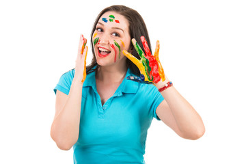 Amazed woman with paints on face and hands