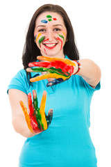 Excited woman with colorful hands