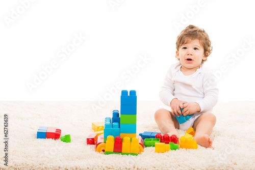 Happy boy playing with building blocks