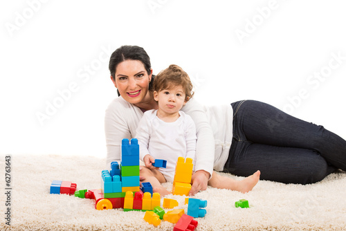 Mother and son on carpet