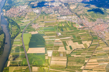 aerial of small village with fields and river rhine