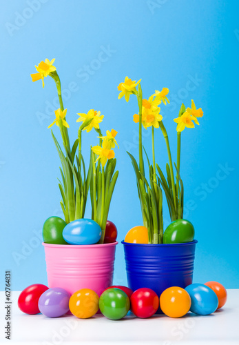 Daffodils and colorful Easter eggs