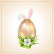 Golden Easter egg and rabbit ears