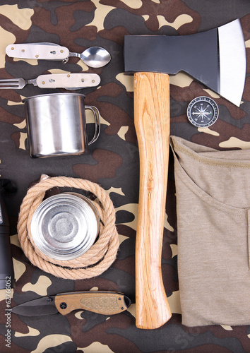 Equipment for trekking on camouflage background