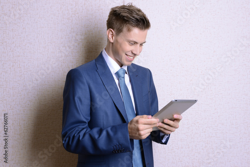 Portrait of businessman near wall