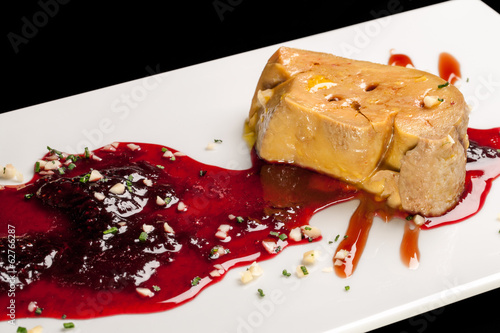 Foie gras with red fruit sauce.