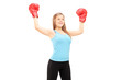 Female boxer gesturing success