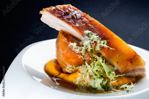 Roasted pork with mashed pumpkin.