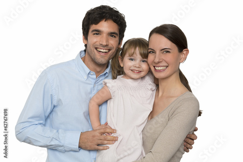 Happy  young Family standing on white background, isolated