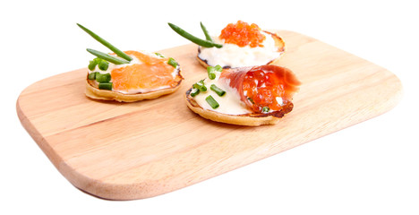 Pancakes with red caviar and salmon