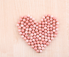 Powder balls on wooden background