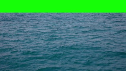 Сamera flies over the waves and fades green screen.