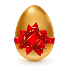 Golden easter egg with red bow