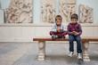 Kids inside Pergamon Museum listening to audio guide. Berlin, Ge