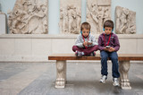 Kids inside Pergamon Museum listening to audio guide. Berlin, Ge