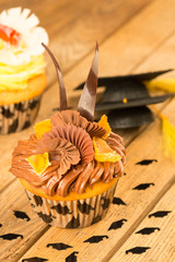 Graduation cupcakes with mortarboard confetti