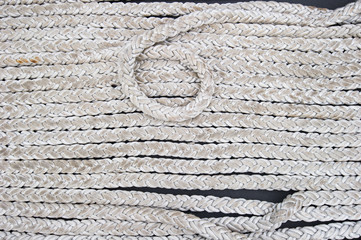 Close-up shot of rope. Taken at a shipyard.