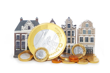 miniature houses and euro coins
