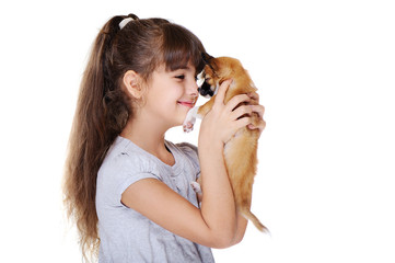little girl holding puppy nose to nose