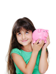smiling girl listening to the piggy bank
