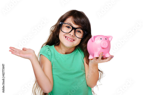 surprised girl holding piggy bank