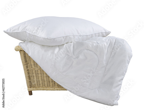 pillow and blanket in wicker basket