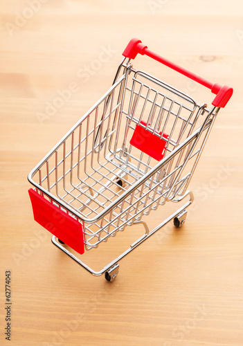 Trolley on wooden background