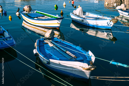 maritime fishing boats moored at dock