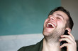 Laughing man enjoying phone call