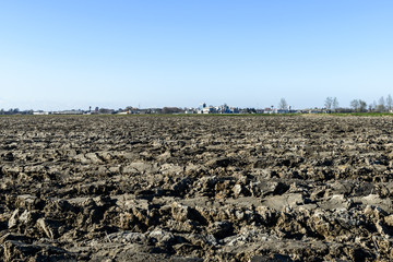 Plowed field and Mortara in background, Lomellina (Italy)