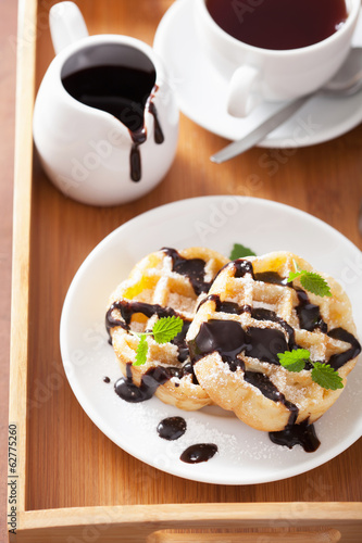 Belgian waffles with chocolate and powder sugar for breakfast