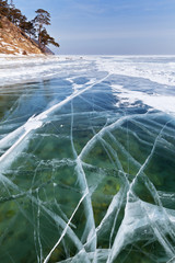 Transparent ice on Baikal Lake in winter sunny day