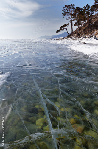 Baikal Lake. The stones on the bottom through the ice