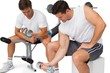 Two fit young men exercising with dumbbells