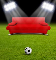 Rote Couch im Fußballstadion